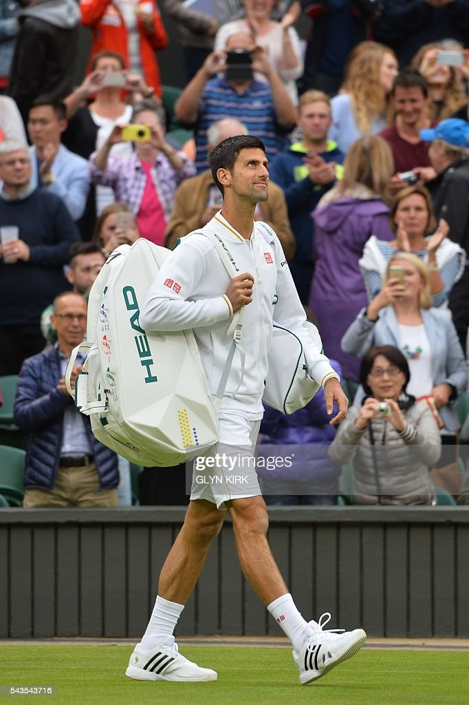 Serbia's Novak Djokovic comes onto centre court to play against France's Adrian Mannarino during their men's singles second round match on the third day of the 2016 Wimbledon Championships at The All England Lawn Tennis Club in Wimbledon, southwest London, on June 29, 2016. / AFP / GLYN