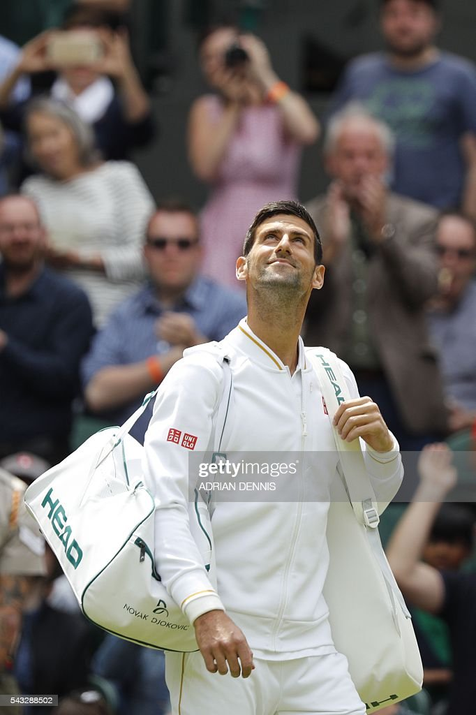 Serbia's Novak Djokovic comes out onto Centre Court to play Britain's James Ward during their men's singles first round match on the first day of the 2016 Wimbledon Championships at The All England Lawn Tennis Club in Wimbledon, southwest London, on June 27, 2016. / AFP / ADRIAN