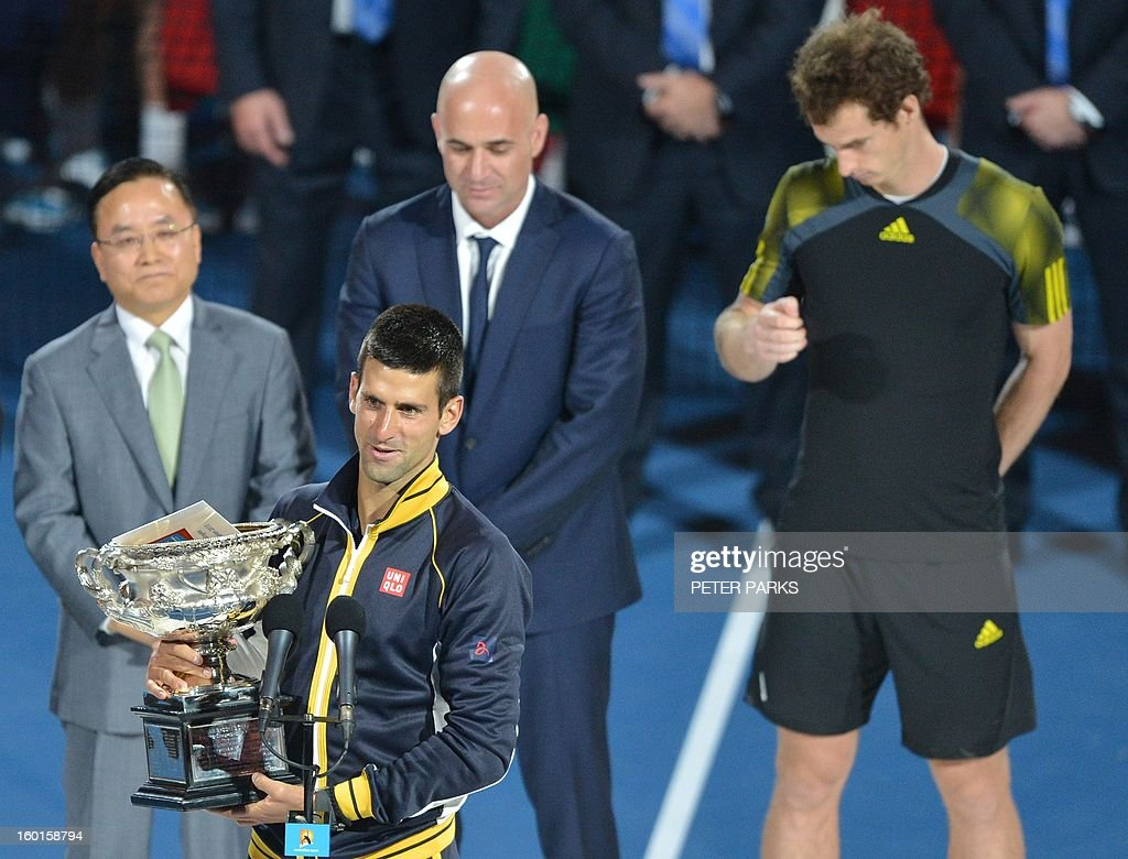 Serbia's Novak Djokovic delivers a speech after his victory over Britain's Andy Murray (R) during the men's singles final on day 14 of the Australian Open tennis tournament in Melbourne on January 27, 2013.