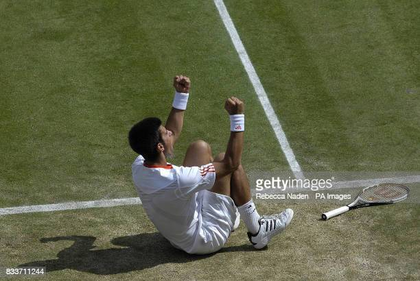 Serbia's Novak Djokovic falls back to celebrate winning a game during the quarterfinal match against Cyprus' Marcos Baghdatis during The All England...
