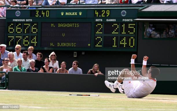 Serbia's Novak Djokovic falls during his match against Cyprus' Marcos Baghdatis during The All England Lawn Tennis Championship at Wimbledon