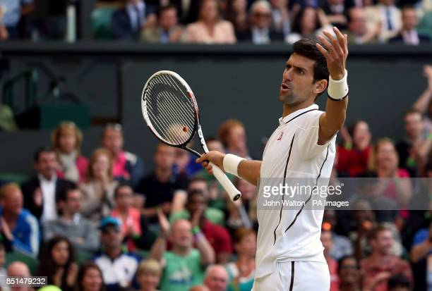 Serbia's Novak Djokovic gestures during his match against Germany's Tommy Haas during day seven of the Wimbledon Championships at The All England...