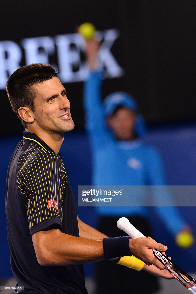 Serbia's Novak Djokovic gestures during his men's singles match against Switzerland's Stanislas Wawrinka on the seventh day of the Australian Open tennis tournament in Melbourne early January 21, 2013.