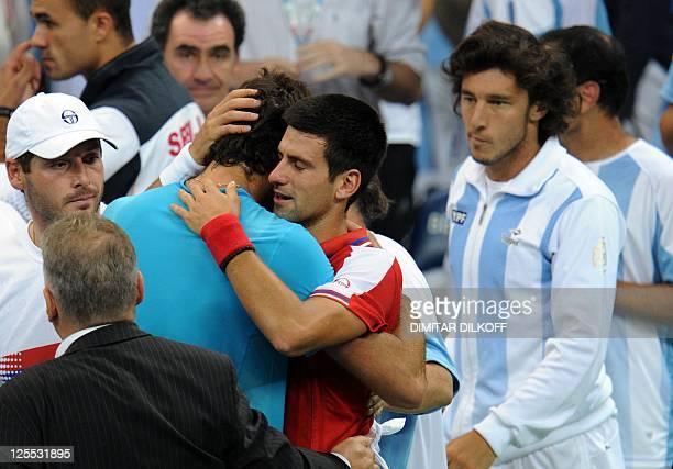Serbia's Novak Djokovic greets Argentina's Juan Martin Del Potro after an injury during their Davis Cup semifinal match at Belgrade Arena on...
