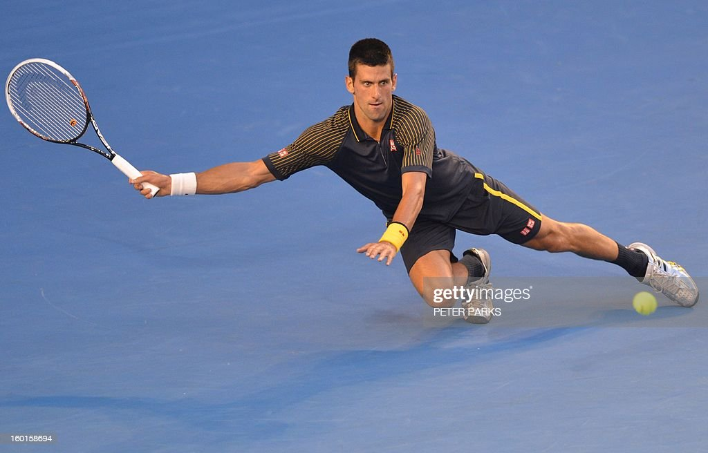 Serbia's Novak Djokovic hits a return against Britain's Andy Murray during the men's singles final on day 14 of the Australian Open tennis tournament in Melbourne on January 27, 2013. AFP PHOTO / PETER PARKS IMAGE STRICTLY RESTRICTED TO EDITORIAL USE - STRICTLY NO COMMERCIAL USE