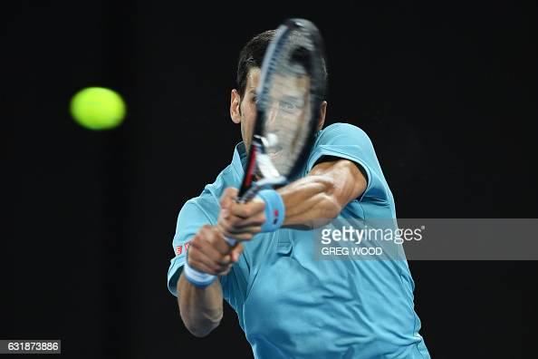 TOPSHOT Serbia's Novak Djokovic hits a return against Spain's Fernando Verdasco during their men's singles match on day two of the Australian Open...