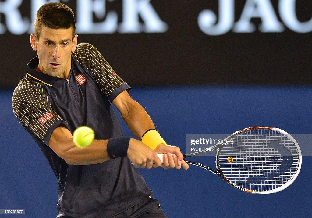Serbia's Novak Djokovic hits a return against Switzerland's Stanislas Wawrinka during their men's singles match on day seven of the Australian Open tennis tournament in Melbourne on January 20, 2013.