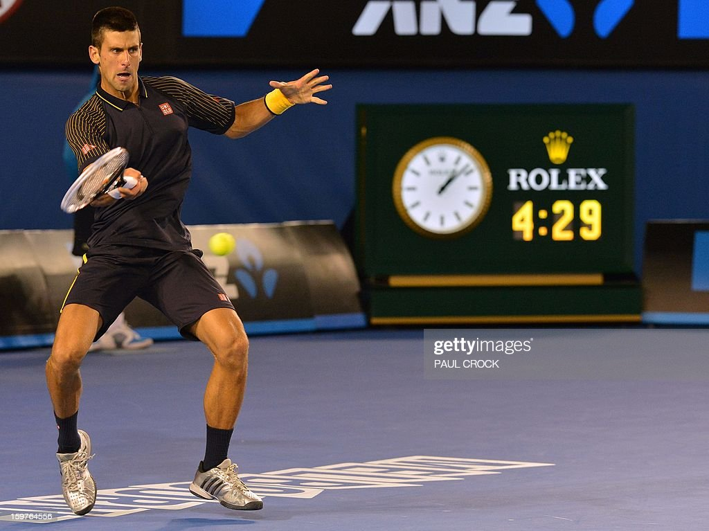 Serbia's Novak Djokovic hits a return against Switzerland's Stanislas Wawrinka during their men's singles match on day seven of the Australian Open tennis tournament in Melbourne early on January 21, 2013.