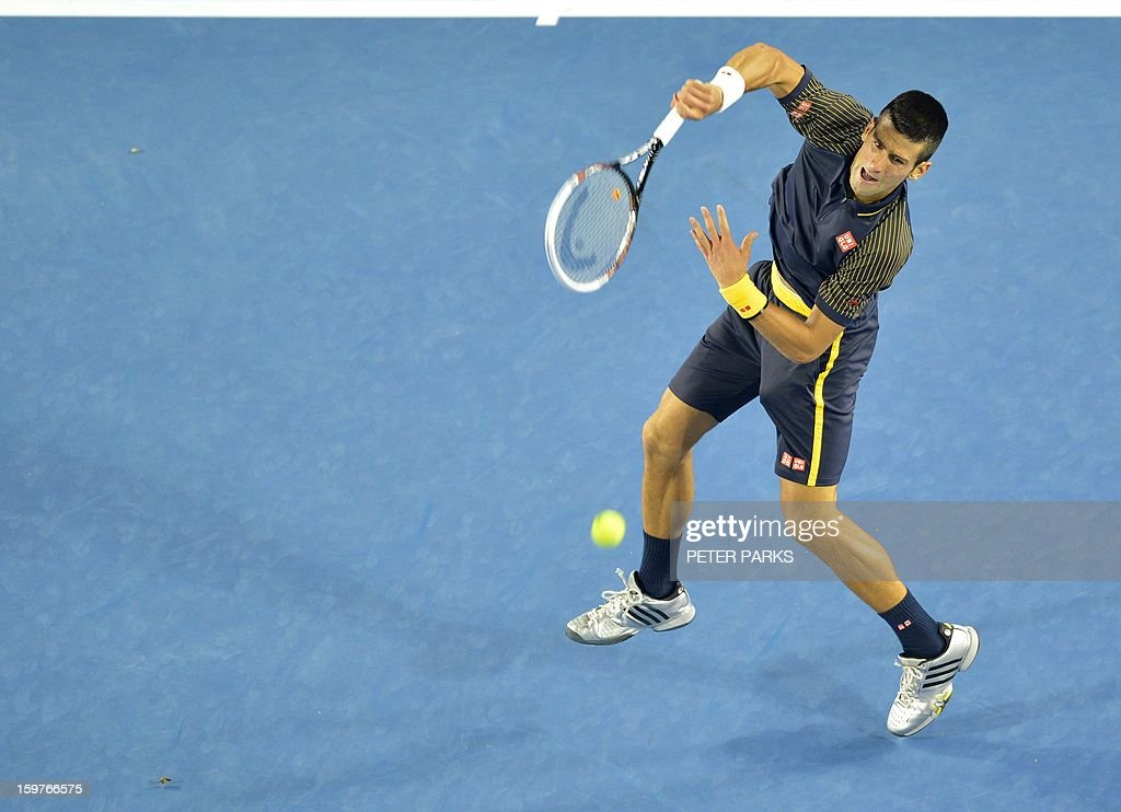 Serbia's Novak Djokovic hits a return against Switzerland's Stanislas Wawrinka during their men's singles match on day seven of the Australian Open tennis tournament in Melbourne early on January 21, 2013. AFP PHOTO / PETER PARKS IMAGE STRICTLY RESTRICTED TO EDITORIAL USE - STRICTLY NO COMMERCIAL USE