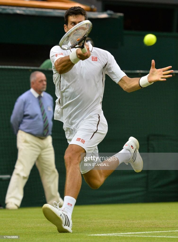Serbia's Novak Djokovic hits a return on the run against US player Bobby Reynolds in their second round men's singles match on day four of the 2013 Wimbledon Championships tennis tournament at the All England Club in Wimbledon, southwest London, on June 27, 2013. Djokovic won 7-6, 6-3, 6-1.