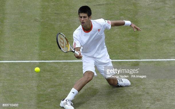 Serbia's Novak Djokovic in action against Cyprus' Marcos Baghdatis during The All England Lawn Tennis Championship at Wimbledon