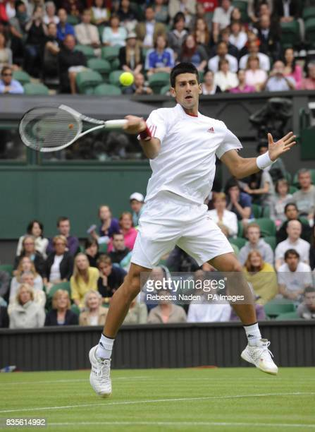 Serbia's Novak Djokovic in action against France's Julien Benneteau during the 2009 Wimbledon Championships at the All England Lawn Tennis and...