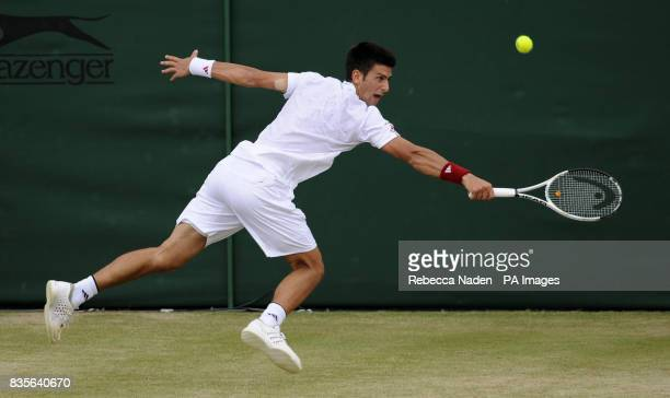 Serbia's Novak Djokovic in action against Israel's Dudi Sela during the Wimbledon Championships at the All England Lawn Tennis and Croquet Club...