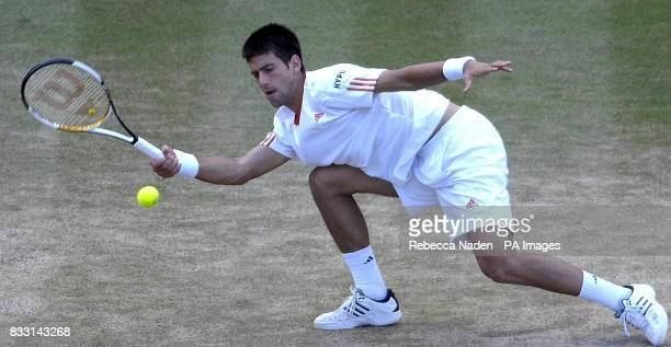Serbia's Novak Djokovic in action against Spain's Rafael Nadal during The All England Lawn Tennis Championship at Wimbledon