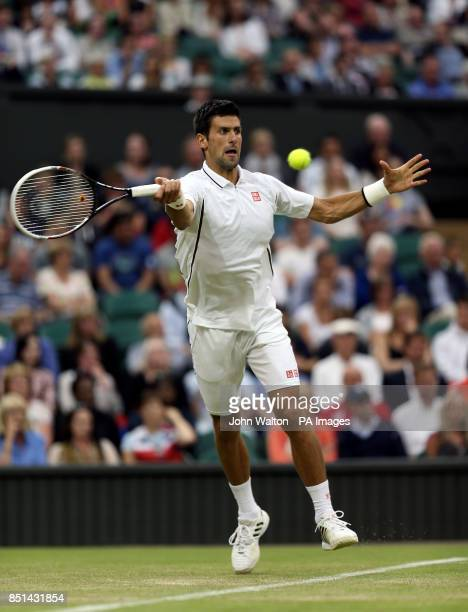 Serbia's Novak Djokovic in action against USA's Bobby Reynolds during day four of the Wimbledon Championships at The All England Lawn Tennis and...