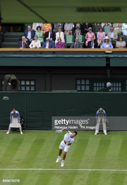 Serbia's Novak Djokovic in action as spectators watch from the Royal Box during the 2009 Wimbledon Championships at the All England Lawn Tennis and...