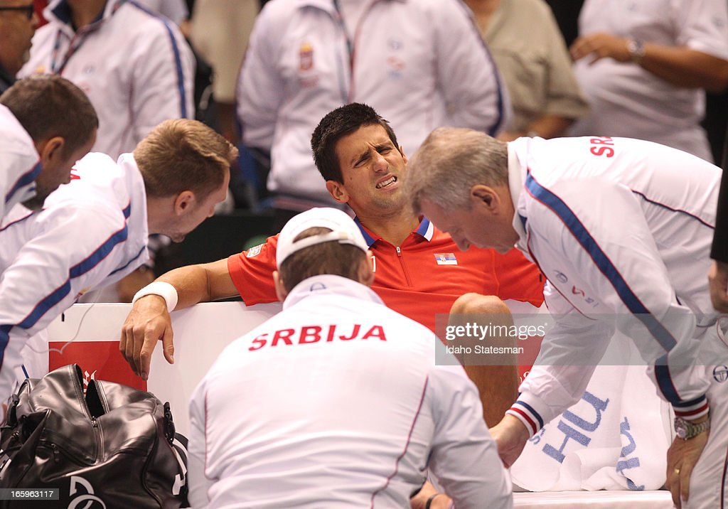 Serbia's Novak Djokovic injured his right leg in a singles match against the United States' Sam Querrey during the Davis Cup quarterfinals in Boise, Idaho, Sunday, April 7, 2013.