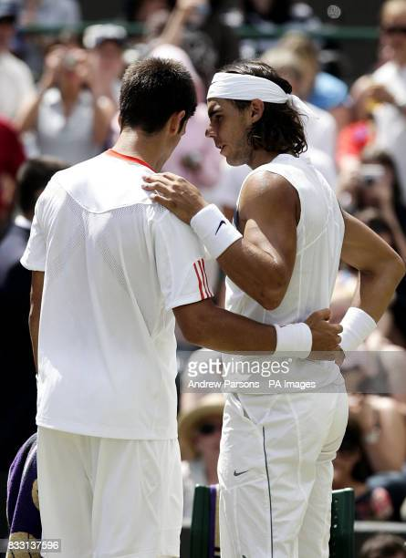 Serbia's Novak Djokovic is consoled by Spain's Rafael Nadal after conceding the semifinal match during The All England Lawn Tennis Championship at...