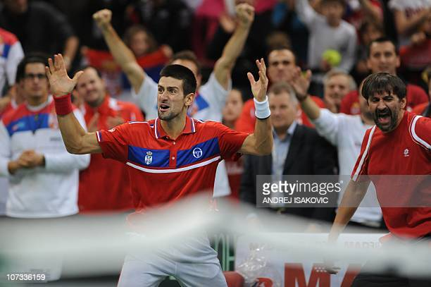 Serbia's Novak Djokovic jubilates after winning against France's Gael Monfils during the Davis Cup tennis match finals between Serbia and France at...