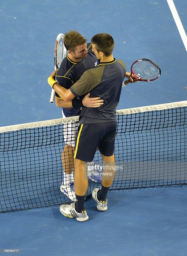 Serbia's Novak Djokovic (R) meets Switzerland's Stanislas Wawrinka at the net after his victory during their men's singles match on day seven of the Australian Open tennis tournament in Melbourne early on January 21, 2013. AFP PHOTO / PETER PARKS IMAGE STRICTLY RESTRICTED TO EDITORIAL USE - STRICTLY NO COMMERCIAL USE