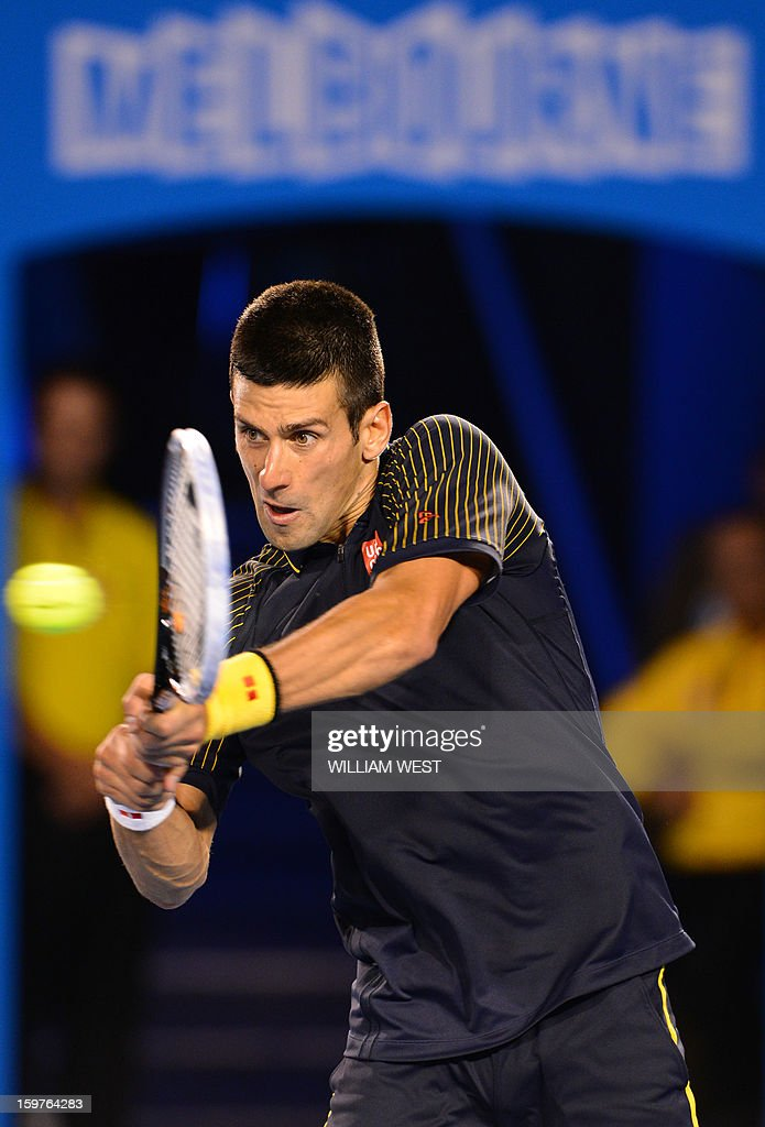 Serbia's Novak Djokovic plays a return during his men's singles match against Switzerland's Stanislas Wawrinka on the seventh day of the Australian Open tennis tournament in Melbourne early January 21, 2013. AFP PHOTO/WILLIAM WEST IMAGE STRICTLY RESTRICTED TO EDITORIAL USE - STRICTLY NO COMMERCIAL USE