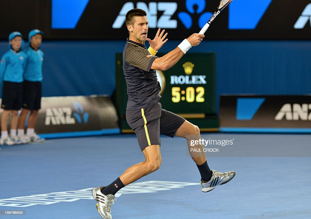 Serbia's Novak Djokovic plays a return during his men's singles match against Switzerland's Stanislas Wawrinka on the seventh day of the Australian Open tennis tournament in Melbourne early January 21, 2013.