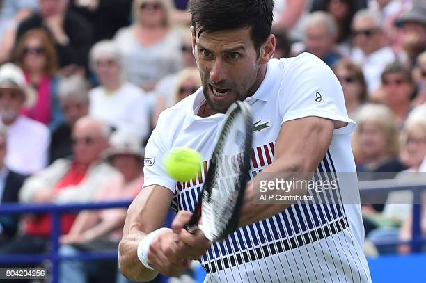 Serbia's Novak Djokovic plays a shot to Russia's Daniil Medvedev during their men's semifinal tennis match at the ATP Aegon International tennis...