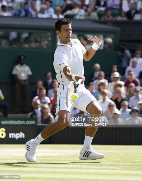 Serbia's Novak Djokovic plays his final shot to win his Semi Final against Bulgaria's Grigor Dimitrov