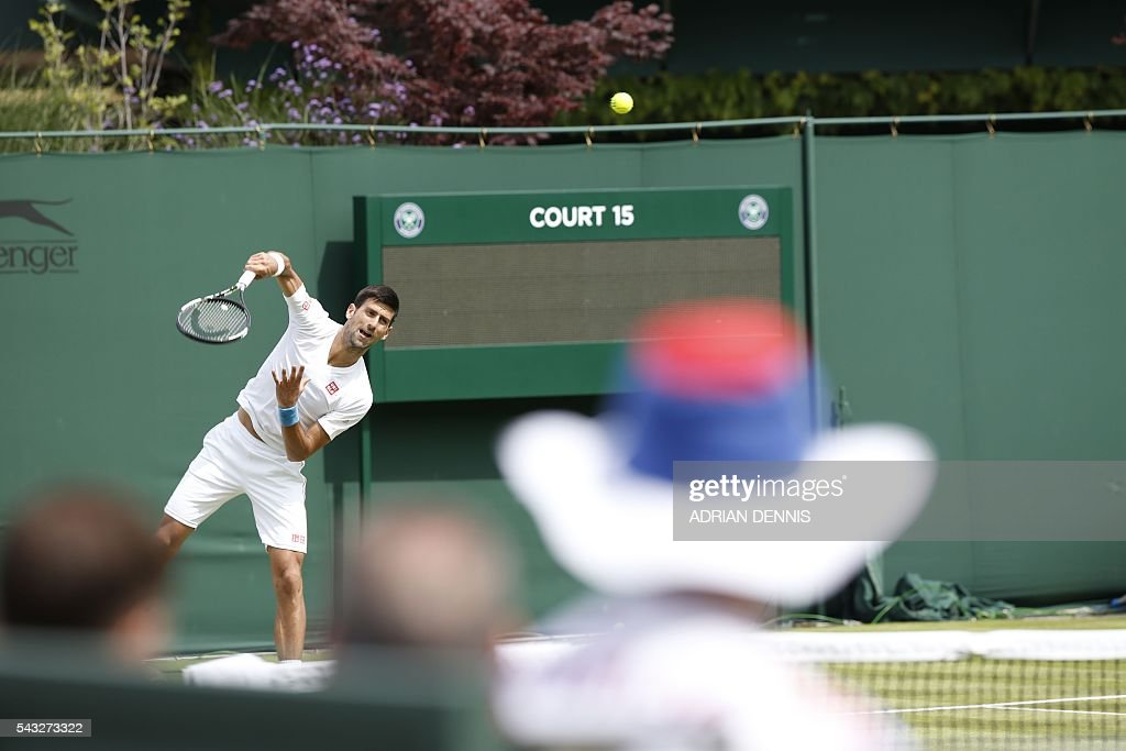 Serbia's Novak Djokovic practices on court 15 ahead of his men's singles first round match against Britain's James Ward on the first day of the 2016 Wimbledon Championships at The All England Lawn Tennis Club in Wimbledon, southwest London, on June 27, 2016. / AFP / ADRIAN