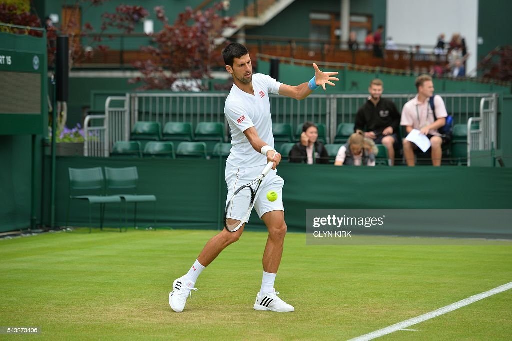 Serbia's Novak Djokovic practices on court 15 ahead of his men's singles first round match against Britain's James Ward on the first day of the 2016 Wimbledon Championships at The All England Lawn Tennis Club in Wimbledon, southwest London, on June 27, 2016. / AFP / GLYN