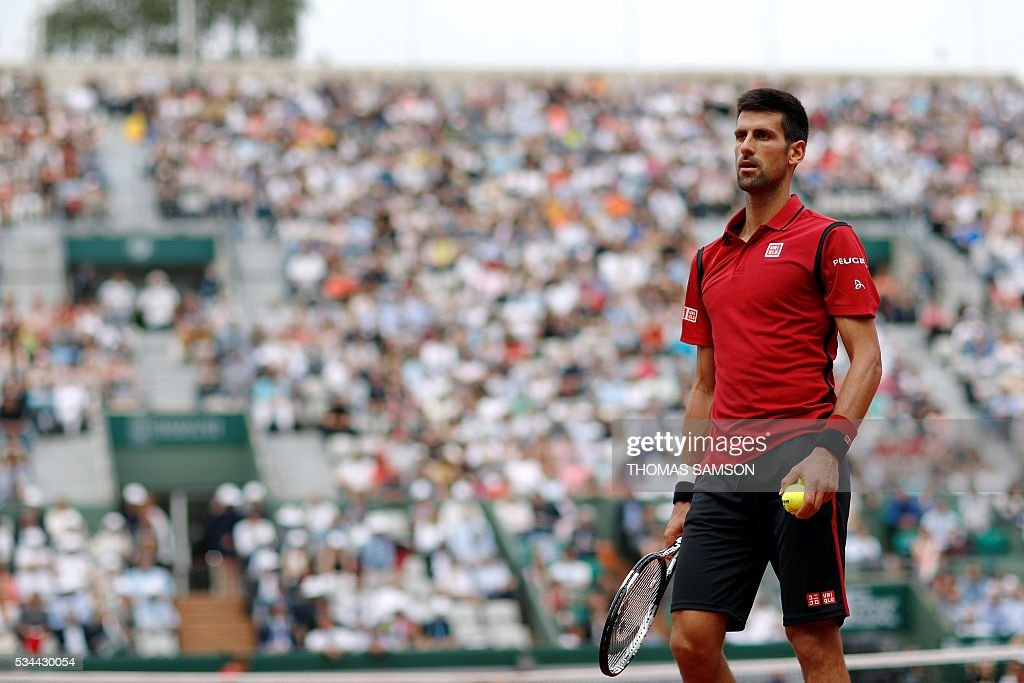 Serbia's Novak Djokovic prepares to serve the ball to Belgium's Steve Darcis during his men's second round match at the Roland Garros 2016 French Tennis Open in Paris on May 26, 2016. / AFP / Thomas SAMSON