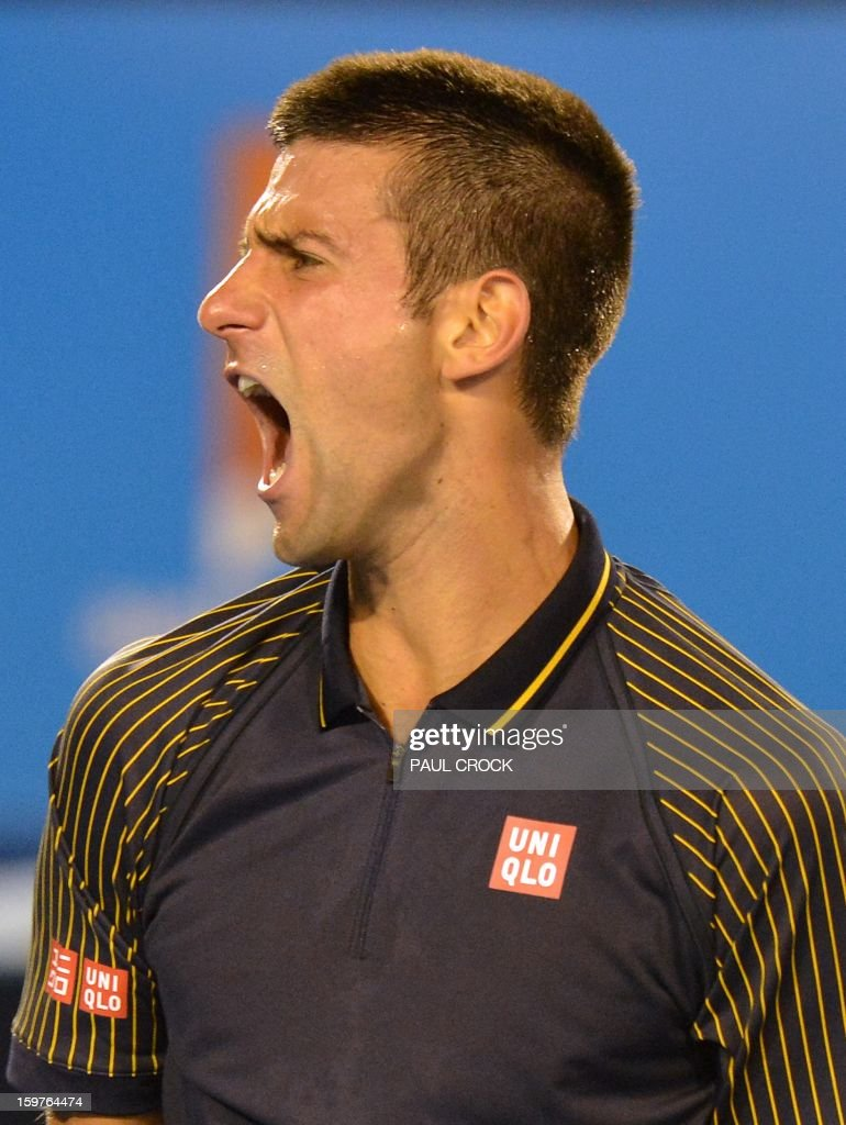 Serbia's Novak Djokovic reacts after a point against Switzerland's Stanislas Wawrinka during their men's singles match on day seven of the Australian Open tennis tournament in Melbourne early on January 21, 2013.