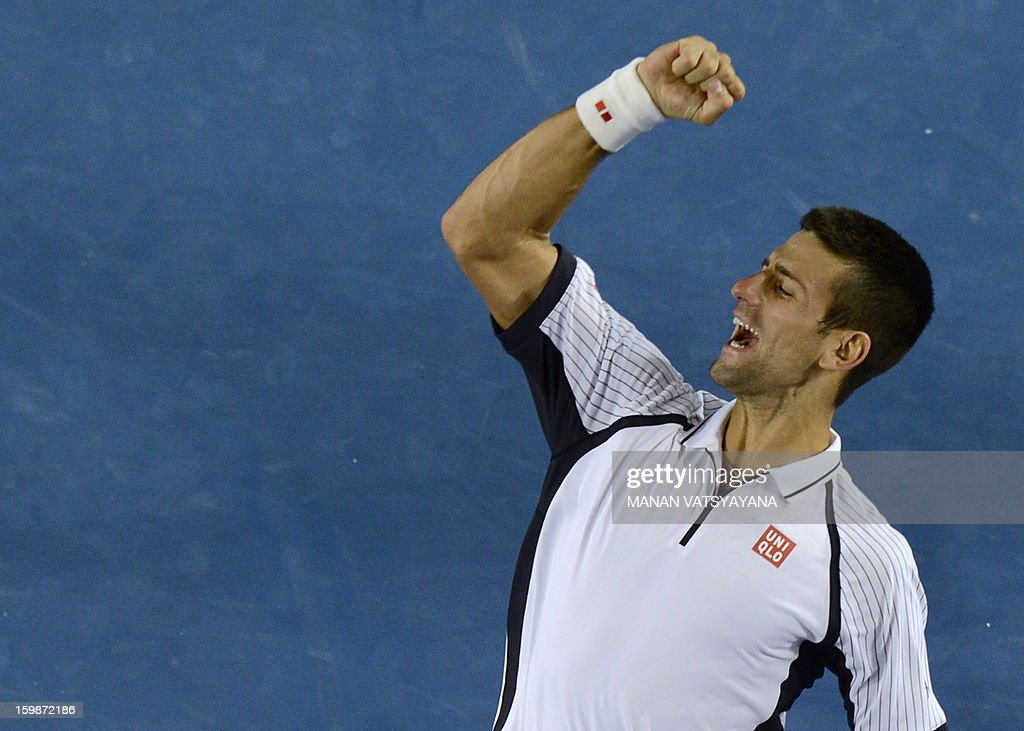 Serbia's Novak Djokovic reacts after his victory against the Czech Republic's Tomas Berdych during their men's singles match on day nine of the Australian Open tennis tournament in Melbourne on January 22, 2013. AFP PHOTO / MANAN VATSYAYANA IMAGE STRICTLY RESTRICTED TO EDITORIAL USE - STRICTLY NO COMMERCIAL USE