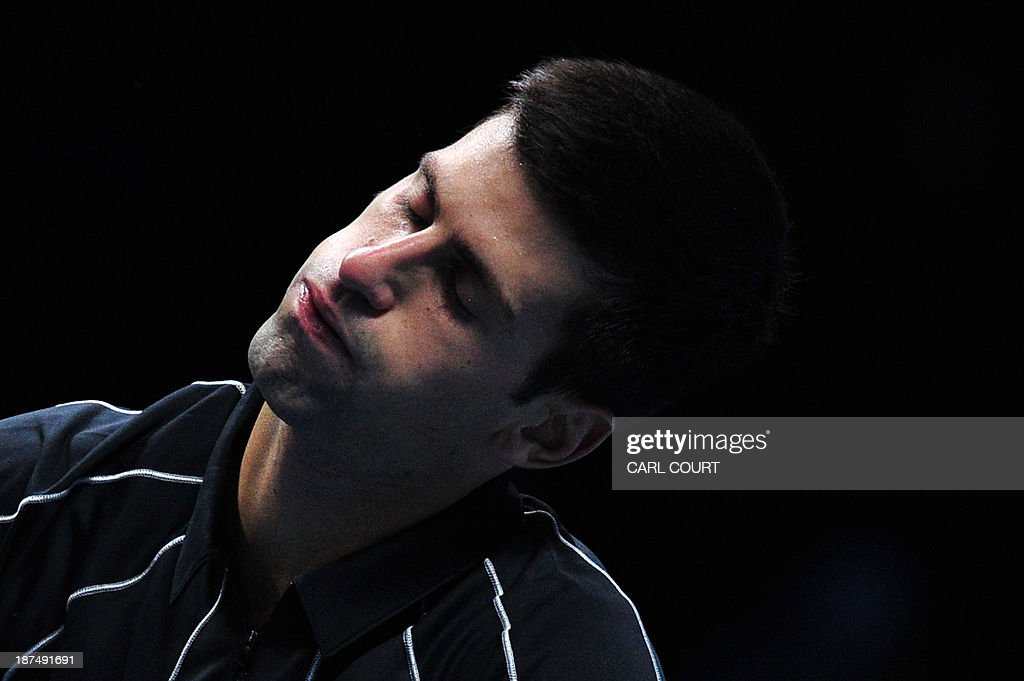 Serbia's Novak Djokovic reacts after netting a return to lose a point against France's Richard Gasquet during their group B singles match in the round robin stage on the sixth day of the ATP World Tour Finals tennis tournament in London on November 9, 2013.
