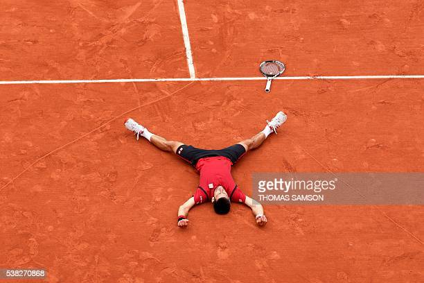 TOPSHOT Serbia's Novak Djokovic reacts after winning the men's final match against Britain's Andy Murray at the Roland Garros 2016 French Tennis Open...