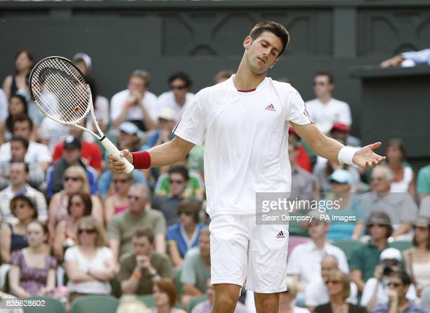 Serbia's Novak Djokovic reacts during his match against USA's Mardy Fish during the Wimbledon Championships 2009 at the All England Tennis Club