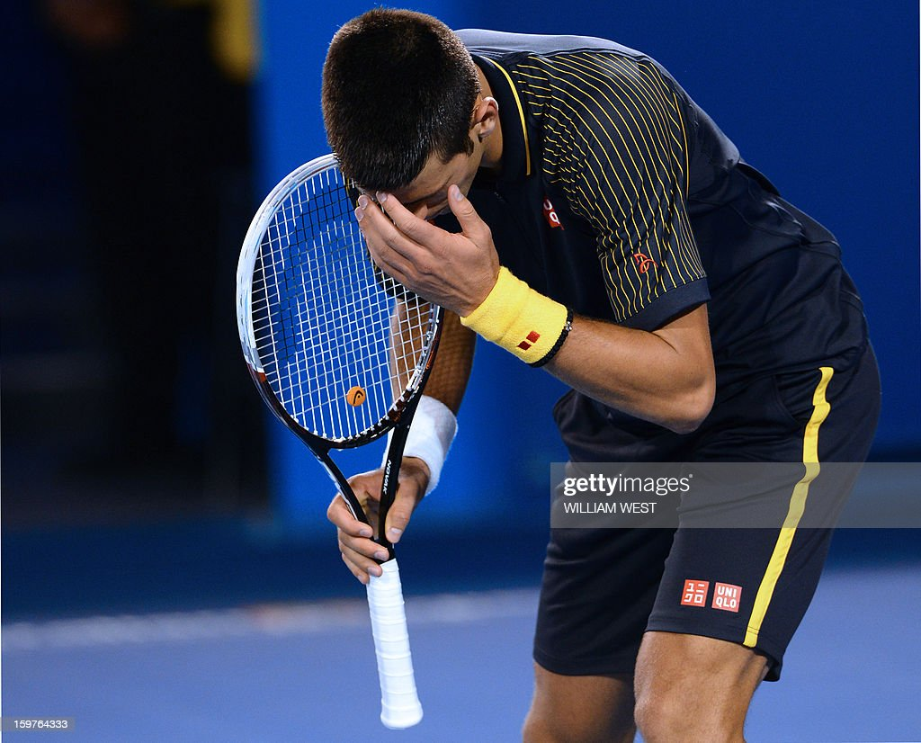 Serbia's Novak Djokovic reacts during his men's singles match against Switzerland's Stanislas Wawrinka on the seventh day of the Australian Open tennis tournament in Melbourne early January 21, 2013. AFP PHOTO/WILLIAM WEST IMAGE STRICTLY RESTRICTED TO EDITORIAL USE - STRICTLY NO COMMERCIAL USE
