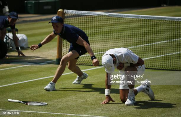 Serbia's Novak Djokovic reacts in his Men's Final against Great Britain's Andy Murray during day thirteen of the Wimbledon Championships at The All...