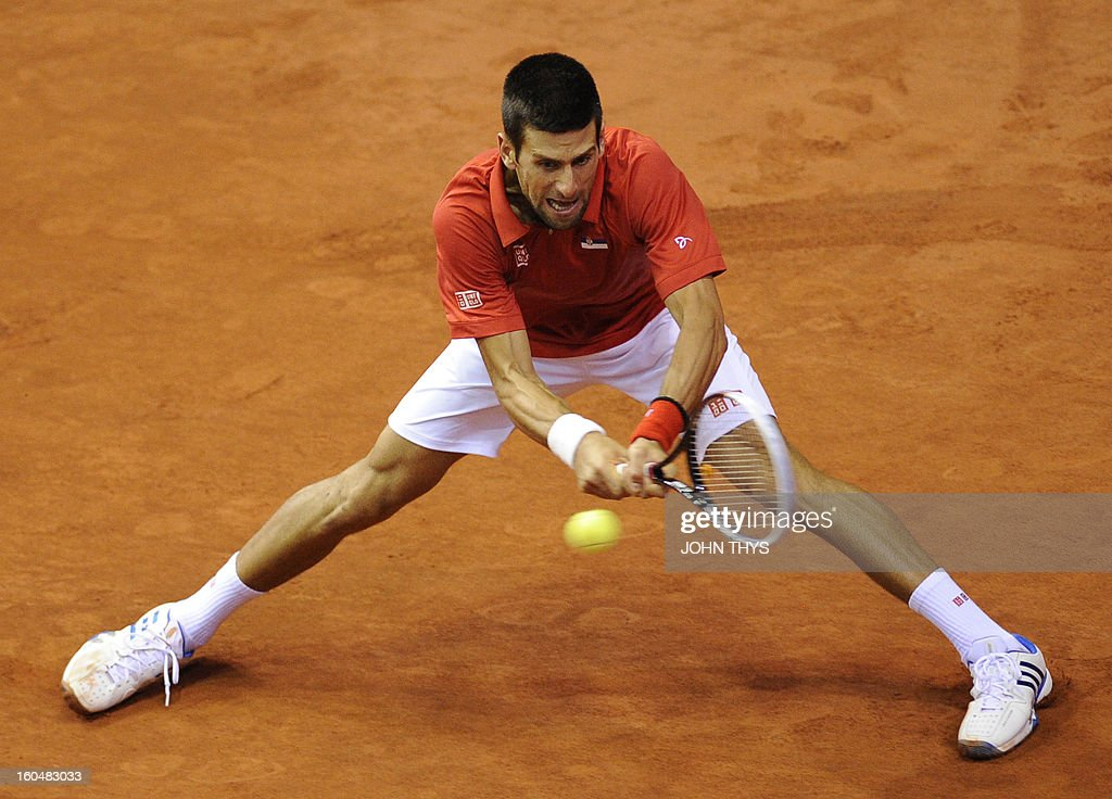 Serbia's Novak Djokovic returns a ball to Belgium's Olivier Rochus during their Davis Cup World Group first round tennis match on February 1, 2013 in Charleroi.