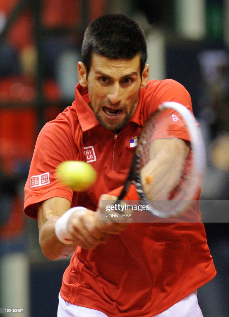 Serbia's Novak Djokovic returns a ball to Belgium's Olivier Rochus during their Davis Cup World Group first round tennis match on February 1, 2013 in Charleroi. AFP PHOTO /JOHN THYS
