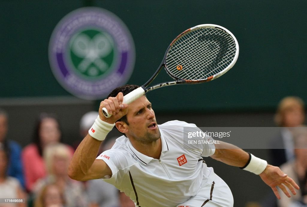 Serbia's Novak Djokovic returns against against US player Bobby Reynolds during their second round men's singles match on day four of the 2013 Wimbledon Championships tennis tournament at the All England Club in Wimbledon, southwest London, on June 27, 2013.