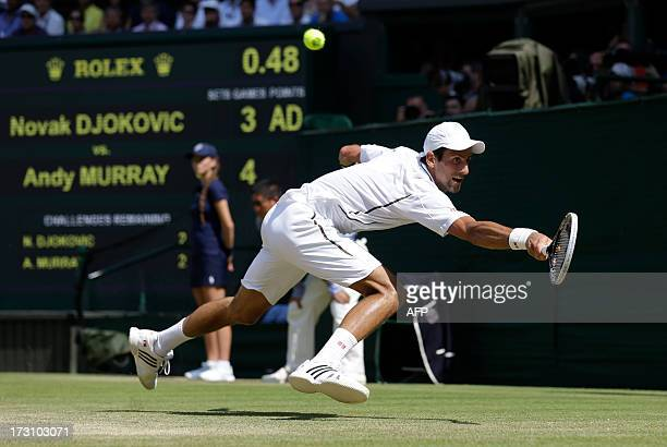 Serbia's Novak Djokovic returns against Britain's Andy Murray during the men's singles final on day thirteen of the 2013 Wimbledon Championships...