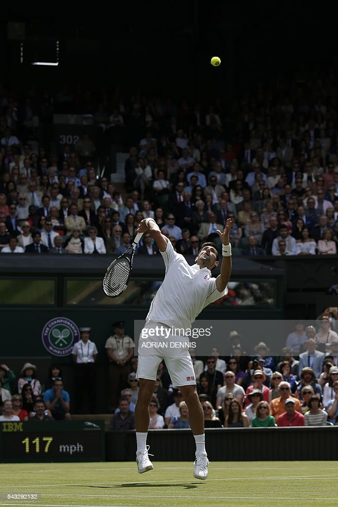 Serbia's Novak Djokovic returns against Britain's James Ward during their men's singles first round match on the first day of the 2016 Wimbledon Championships at The All England Lawn Tennis Club in Wimbledon, southwest London, on June 27, 2016. / AFP / ADRIAN