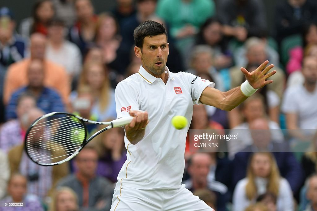 Serbia's Novak Djokovic returns against France's Adrian Mannarino during their men's singles second round match on the third day of the 2016 Wimbledon Championships at The All England Lawn Tennis Club in Wimbledon, southwest London, on June 29, 2016. / AFP / GLYN