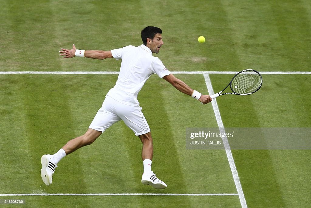 Serbia's Novak Djokovic returns against France's Adrian Mannarino during their men's singles second round match on the third day of the 2016 Wimbledon Championships at The All England Lawn Tennis Club in Wimbledon, southwest London, on June 29, 2016. / AFP / JUSTIN