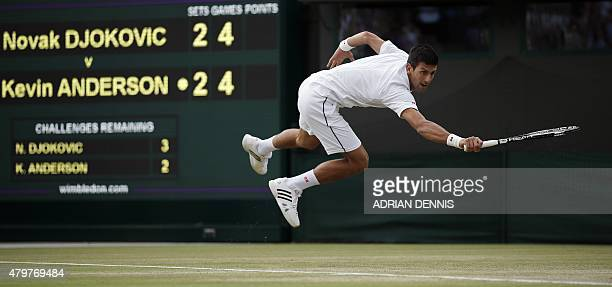 Serbia's Novak Djokovic returns against South Africa's Kevin Anderson during their men's singles fourth round match on day eight of the 2015...