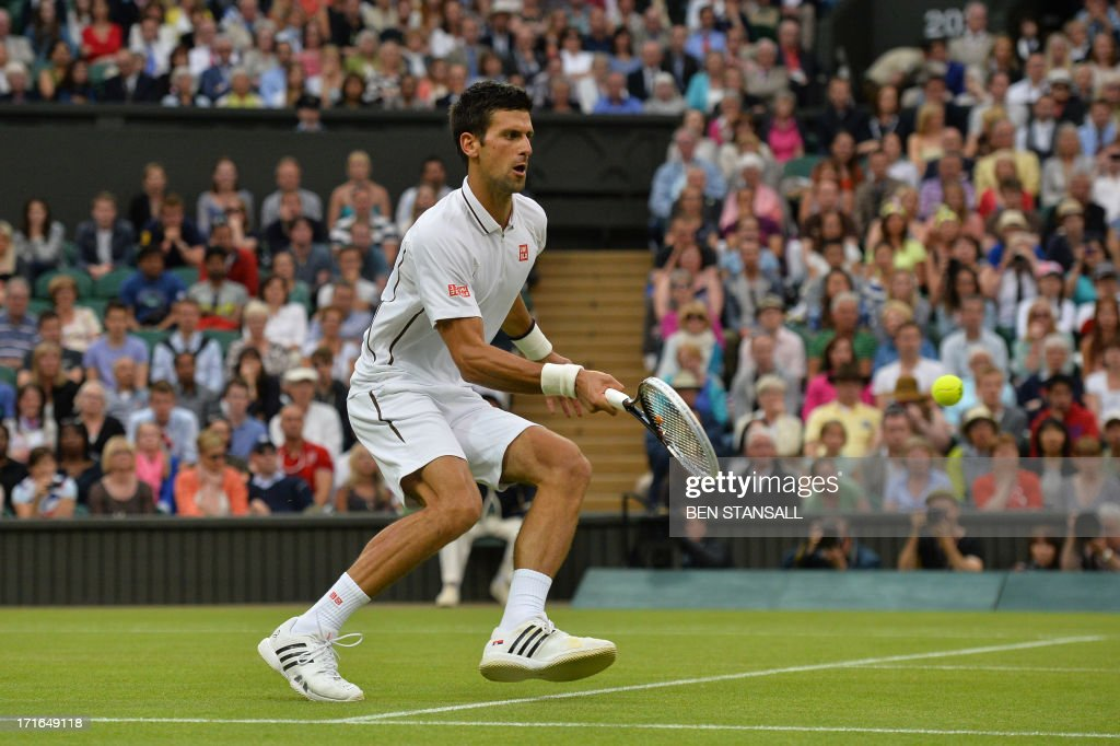 Serbia's Novak Djokovic returns against US player Bobby Reynolds during their second round men's singles match on day four of the 2013 Wimbledon Championships tennis tournament at the All England Club in Wimbledon, southwest London, on June 27, 2013.