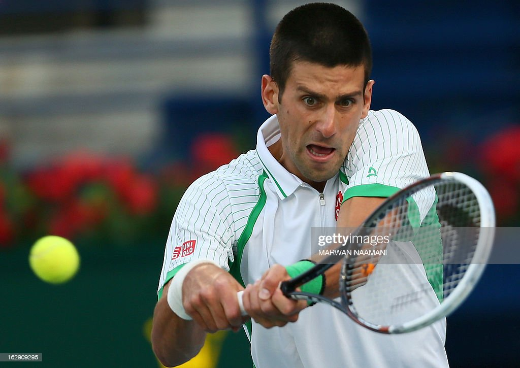 Serbia's Novak Djokovic returns the ball to Argentina's Juan Martin Del Potro during their ATP Dubai Open tennis semi-final match in the Gulf emirate on March 01, 2013. AFP PHOTO/MARWAN NAAMANI