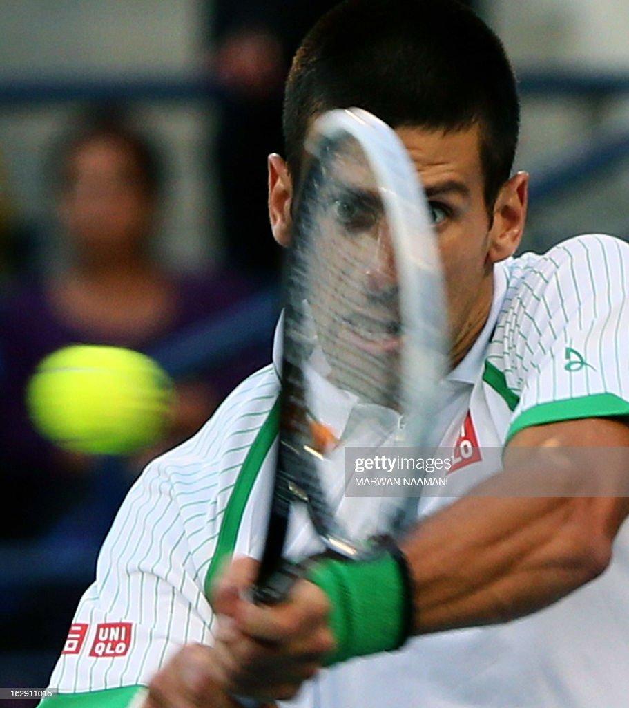 Serbia's Novak Djokovic returns the ball to Argentina's Juan Martin Del Potro during their ATP Dubai Open tennis semi-final match in the Gulf emirate on March 01, 2013.