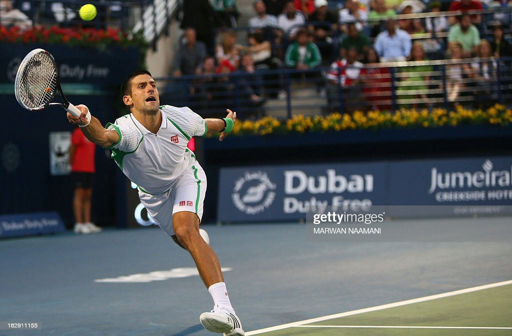 Serbia's Novak Djokovic returns the ball to Argentina's Juan Martin Del Potro during their ATP Dubai Open tennis semi-final match in the Gulf emirate on March 1, 2013. Djokovic won the match 6-3, 7-6.
